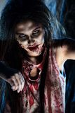 Zombie dark. Bloodthirsty zombi standing at the night cemetery in the mist and moonlight Stock Photos
