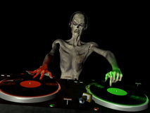 Zombie DJ 1. Zombie's in the House and mixing up some Halloween horror.  Turntables with vinyl albums Stock Image