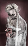 Zombie bride. Is a zombie dressed in a wedding dress stock image