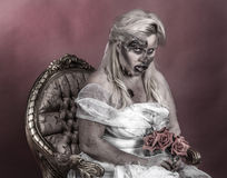 Zombie bride. Is a zombie dressed in a wedding dress stock photo
