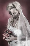 Zombie bride. Is a zombie dressed in a wedding dress royalty free stock photos