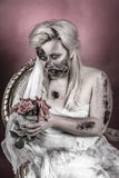Zombie bride. Is a zombie dressed in a wedding dress royalty free stock image