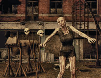 Zombie in front of a destroyed building Stock Photos