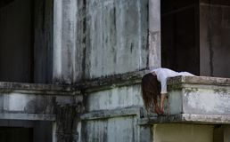 Zombie Ghost woman murder on abandoned building with bloody stock photography