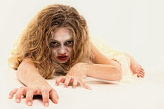 Zombie Girl. Adorable 7 year old girl in Zombie costume over white background Stock Photos