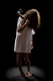 Zombie girl with axe. On black Royalty Free Stock Photos