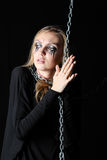 Zombie girl with black tears and cut throat holds chain stock images