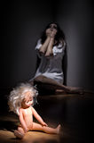 Zombie girl with doll. Zombie girl with plastic doll Royalty Free Stock Photo