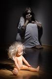 Zombie girl with doll Royalty Free Stock Photo