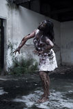 Zombie girl in haunted house. Scary lot Royalty Free Stock Photo