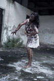 Zombie girl in haunted house Royalty Free Stock Photography