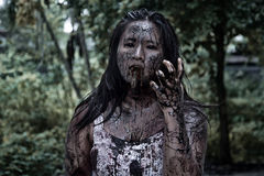 Zombie girl in haunted house Stock Images