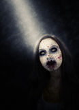 Zombie Girl Illuminated by Spotlight Royalty Free Stock Images