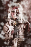 Zombie girl making phone call to dead valentine Royalty Free Stock Photo