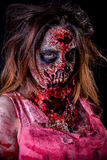 Zombie girl portrait. Portrait of zombie girl with bloody makeup and latex prosthesis stock photo