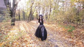 Zombie girl walks through the forest. stock video footage
