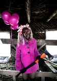 Zombie girl. With a bunch of pink balloons Royalty Free Stock Photo