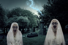 Zombie Graveyard Ghosts With Lightening. Photo Of Zombie Graveyard Ghosts With Lightening Stock Images