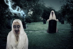 Zombie Graveyard Ghosts With Lightening Royalty Free Stock Image