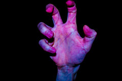 Zombie hand on a black background. Men`s zombie hand on a black background Stock Photos