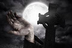 Zombie hand bursting from the grave Stock Image