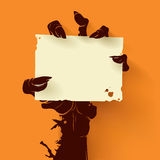 Zombie hand with card Stock Photo