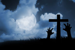 Zombie hand coming out of his grave. Halloween concept Stock Photos