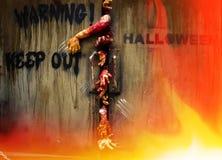 Zombie hand through the door Stock Photo