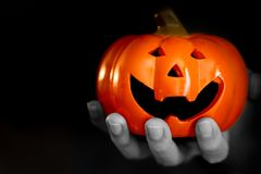 Zombie hand with helloween smile pumpkin nightmare trick or treat royalty free stock photography