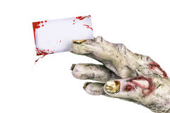 Zombie hand holding a bloody blank business card. Stock Photography