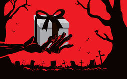 Zombie hand holding gift box at the grave Stock Photography