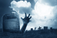 Zombie hand out from the graveyard Royalty Free Stock Photos