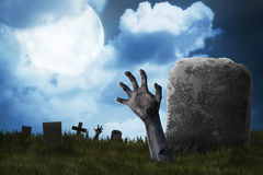 Zombie hand out from the graveyard. Halloween concept Stock Images