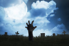 Zombie hand out from the graveyard Royalty Free Stock Images
