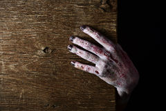 Zombie hand popping up Stock Images