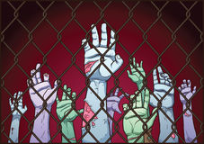 Zombie hands. Behind a fence. Vector clip art illustration with simple gradients. Fence and hands on separate layers Stock Photos