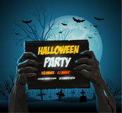 Zombie hands holding a halloween poster ad Royalty Free Stock Image