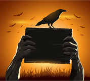 Zombie hands holding sign with blank card as a creepy halloween or scary symbol  crow Royalty Free Stock Image