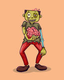 Zombie holding brain in hand Stock Images