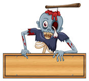 A zombie holding an empty signboard Royalty Free Stock Images