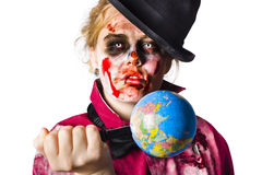 Zombie holding knife in globe Royalty Free Stock Photo