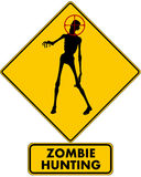 Zombie Hunting. A caution road sign warning you that zombies are being hunted in the immediate area, pictured with a zombie reaching out with a target on its stock illustration