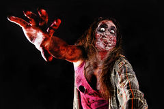 Zombie. Isolated in dark background Royalty Free Stock Photo