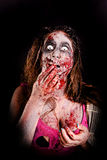 Zombie. Isolated in dark background Royalty Free Stock Photography