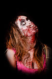 Zombie. Isolated in dark background Royalty Free Stock Image