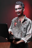 Zombie with laptop Royalty Free Stock Photography