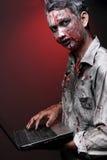 Zombie with laptop Stock Photos