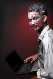 Zombie with laptop Stock Image