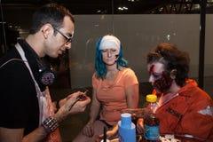 Zombie makeup at Cartoomics 2014. MILAN, ITALY - MARCH 14: Zombie makeup on a girl at Cartoomics, event dedicated to comics, cartoons, cosplay, fantasy and royalty free stock photography