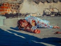 Zombie man crawls on asphalt Royalty Free Stock Image